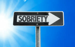 A road sign pointing to the path of Addiction recovery.